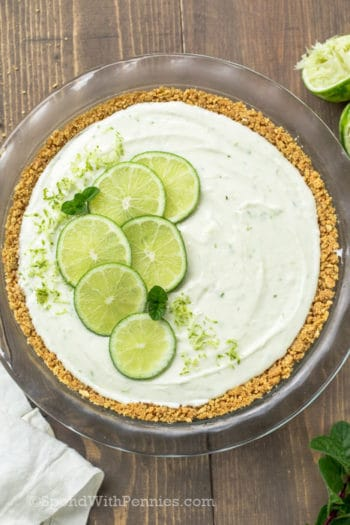 No Bake Key Lime Pie with limes on top shown overhead