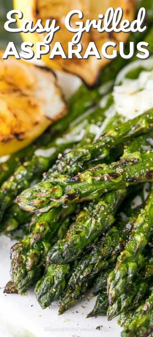 Grilled asparagus on a plate with grilled lemon shown with a title