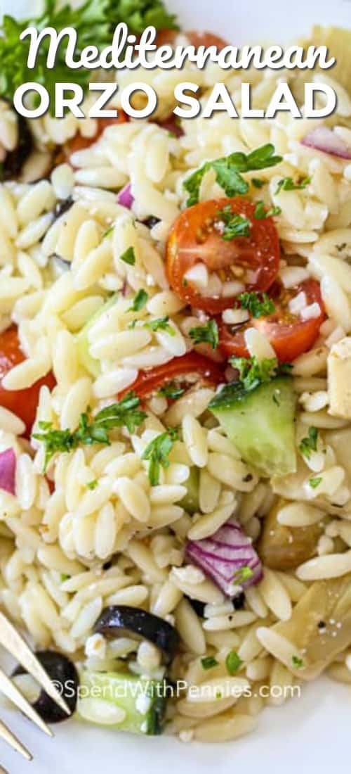 This Mediterranean Orzo Salad is a hit every time I make it! With orzo, tomatoes, cucumbers, artichoke hearts, feta, and olives all tossed in an easy Greek dressing, it's simple to prepare and tastes delicious. #spendwithpennies #orzosalad #pastasalad #sidedish #mediterraneansalad #greeksalad
