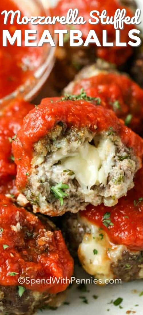 One Mozzarella Stuffed Meatball sliced open showing a melted mozzarella ball inside