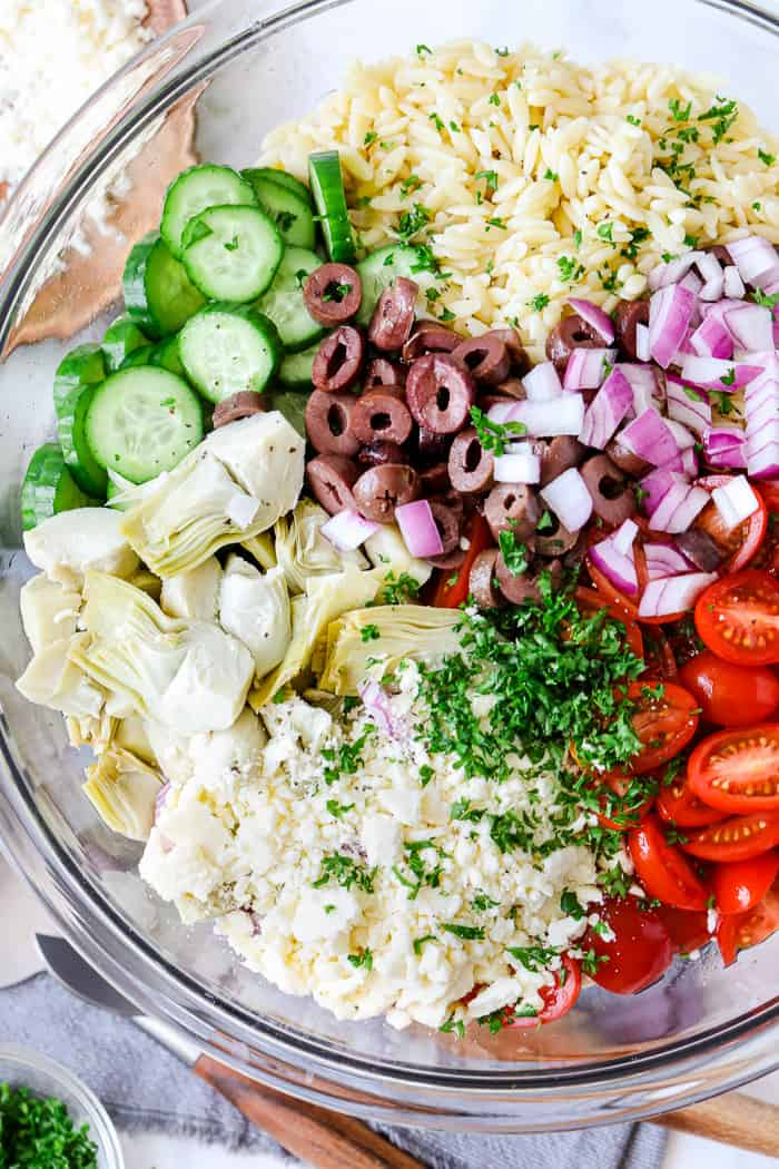 Ingredients to prepare orzo salad in a bowl