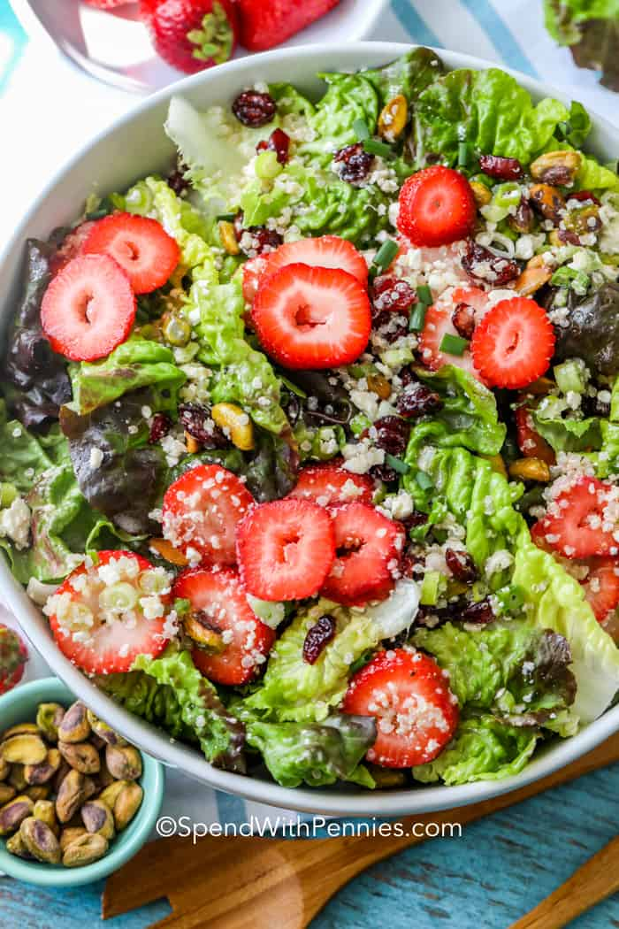 A serving bowl full of pistachio strawberry salad ready to serve.