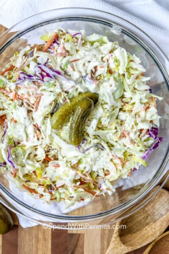 dill pickle coleslaw garnished with pickles