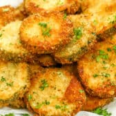 Fried Zucchini served on a white plate