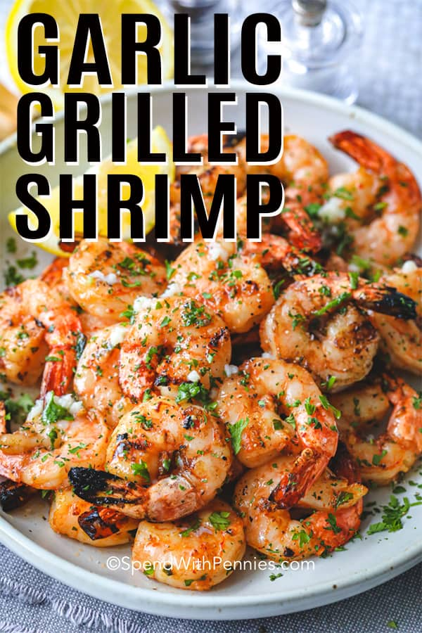 Garlic Grilled Shrimp on a plate with lemon shown with a title