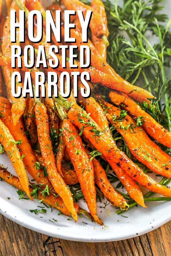 Honey Roasted Carrots on a plate with parsley with a title