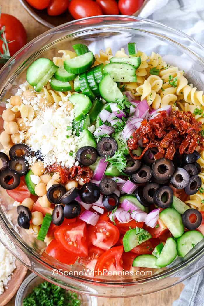 Mediterranean Pasta Salad ingredients in a bowl.