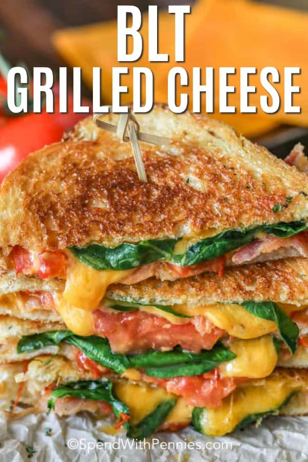 The ultimate BLT grilled cheese is a combination of bacon, spinach, tomatoes, and cheese grilled between two slices of bread. With a mayo spread instead of butter, it grills to the perfect golden brown and crispy texture everyone loves! It's the ultimate comfort food, perfect for lunch, dinner or even a snack. #spendwithpennies #bltgrilledcheese #grilledcheesesandwich #lunch #sandwichrecipe