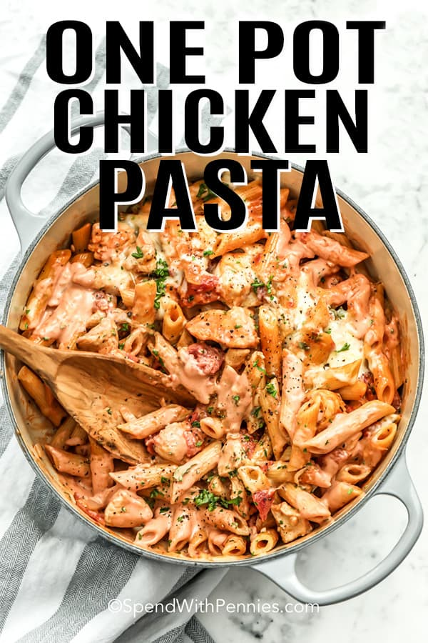 One Pot Chicken Pasta in a white pot with a wooden spoon
