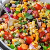 Black Bean Corn Salad in a bowl with a spoon