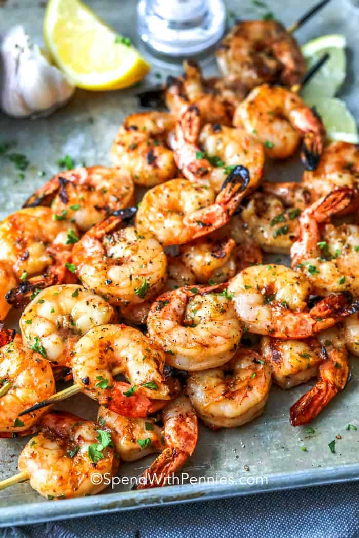Shrimp skewers on a baking tray.