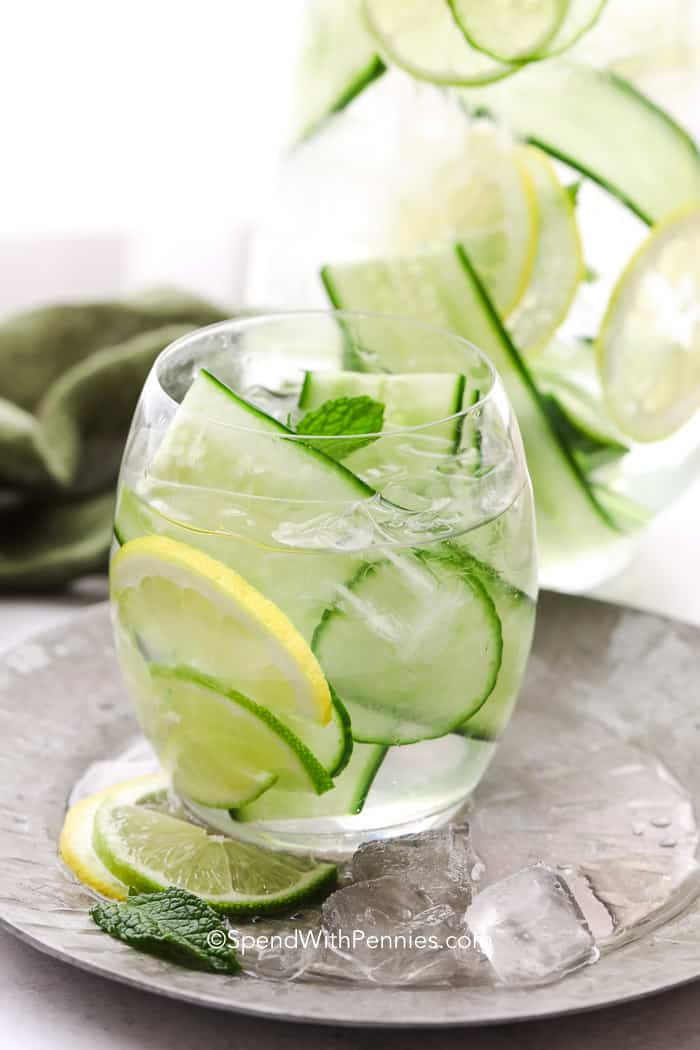Glass of Cucumber Water on a metal plate