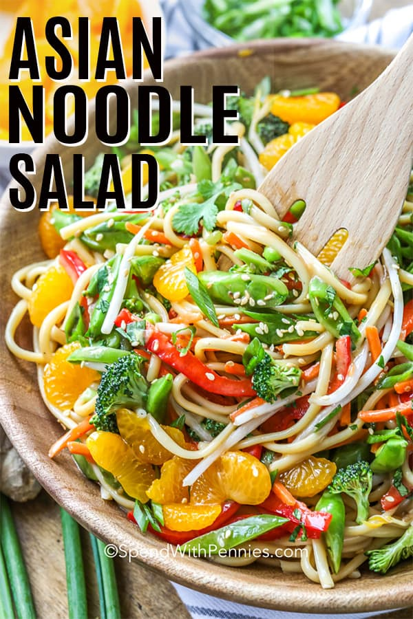 Asian Noodle Salad served in a wooden bowl with a title
