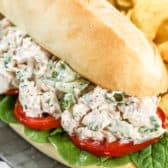 Bacon Ranch Chicken Salad on a hoagie roll with greens and tomato