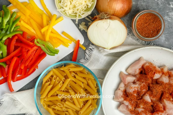 Ingredients for chicken fajita pasta on a marble board