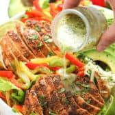pouring dressing on to Chicken Fajita Salad