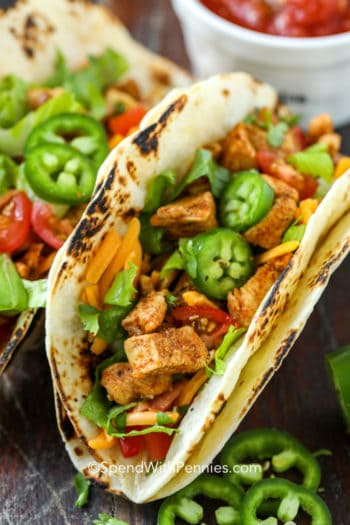 Chicken tacos with jalapenos and lettuce