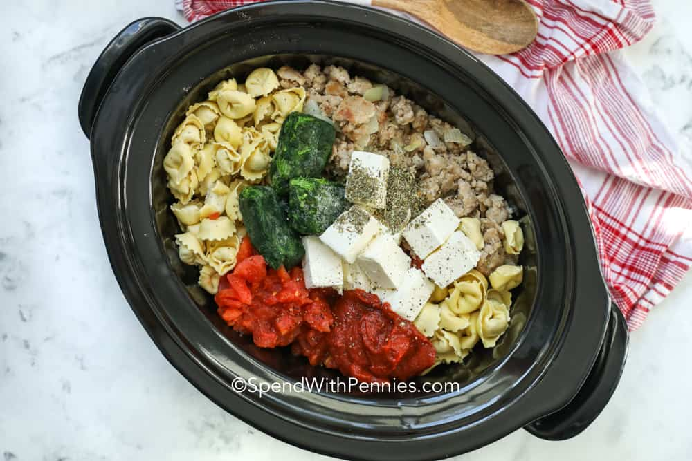 Creamy tortellini ingredients in a crockpot.