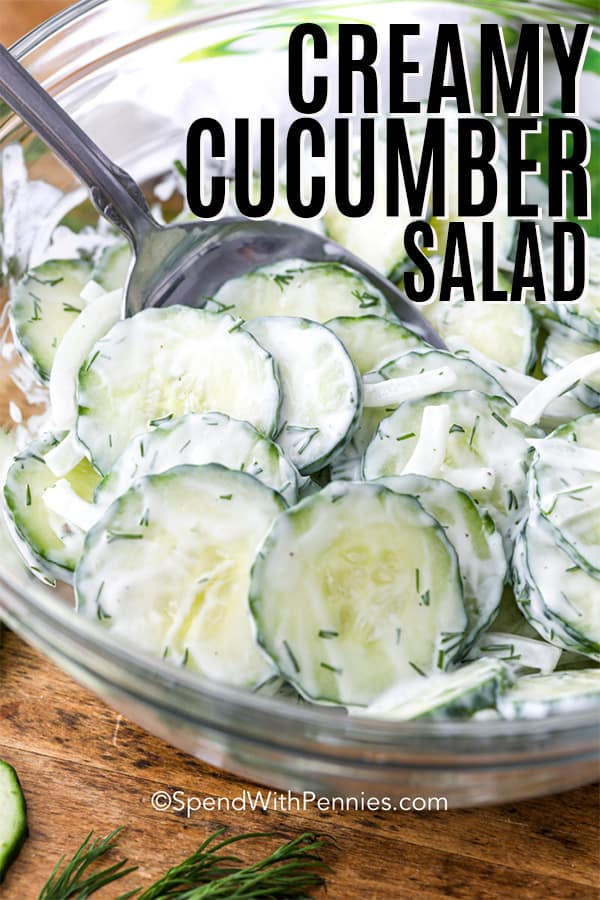Creamy Cucumber Salad in a glass bowl with a spoon with a title