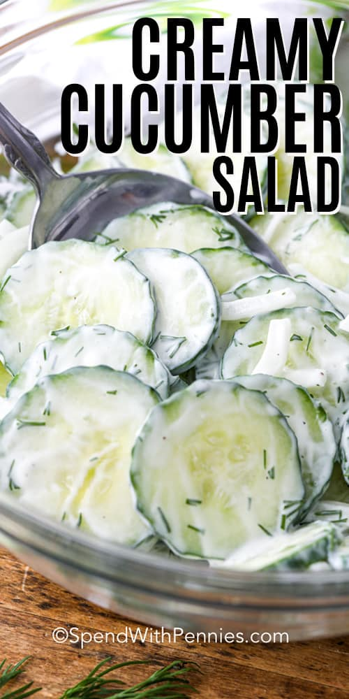 Creamy Cucumber Salad in a mixing bowl with a spoon with a title