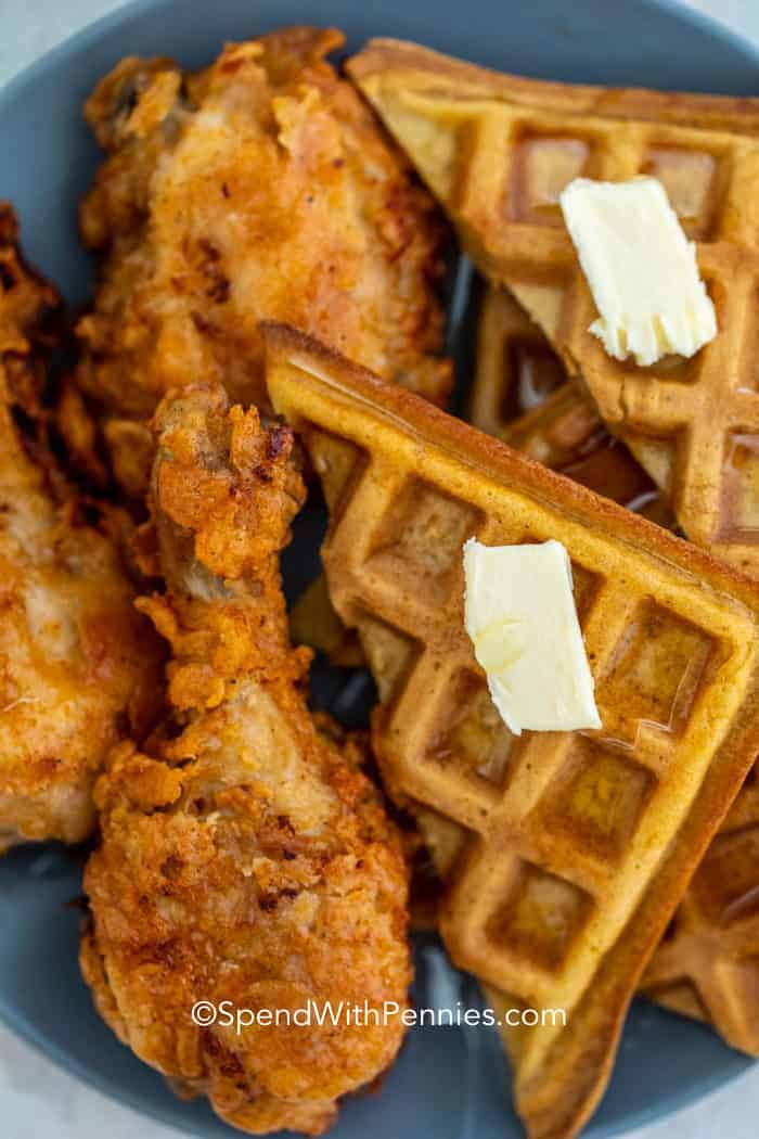 Overhead shot of Fried Chicken and Waffles on a blue plate