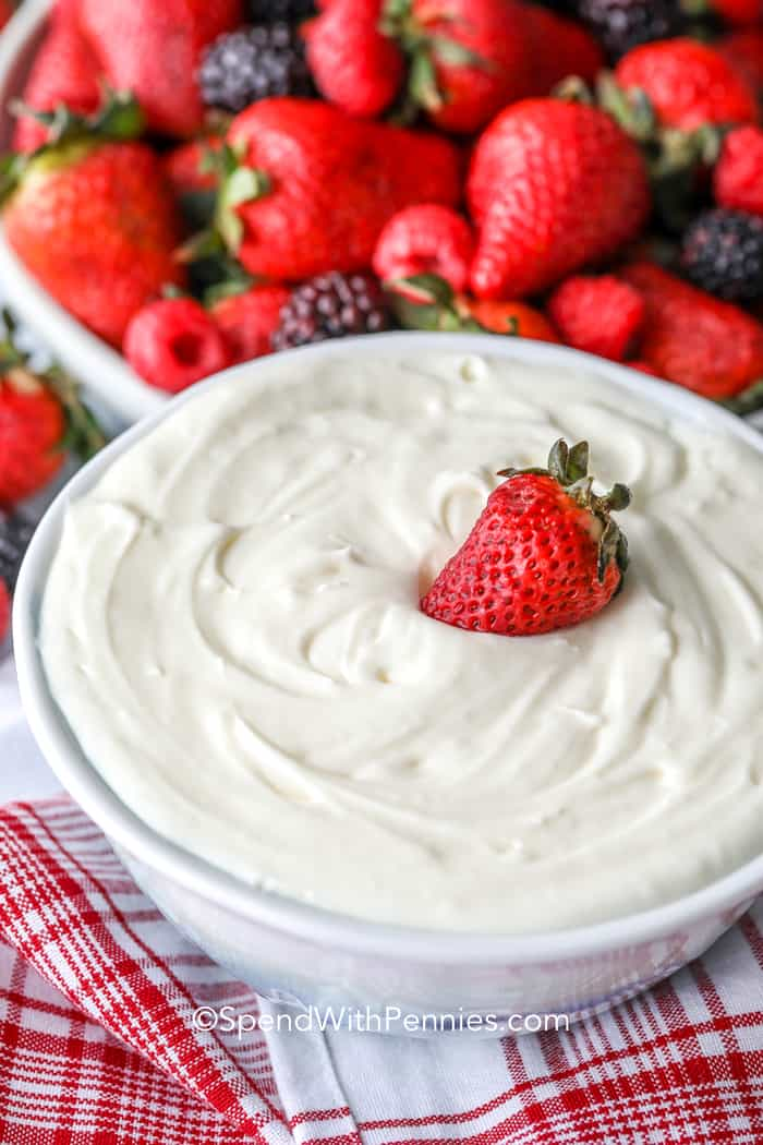 Fruit dip in a white bowl with a strawberry on top