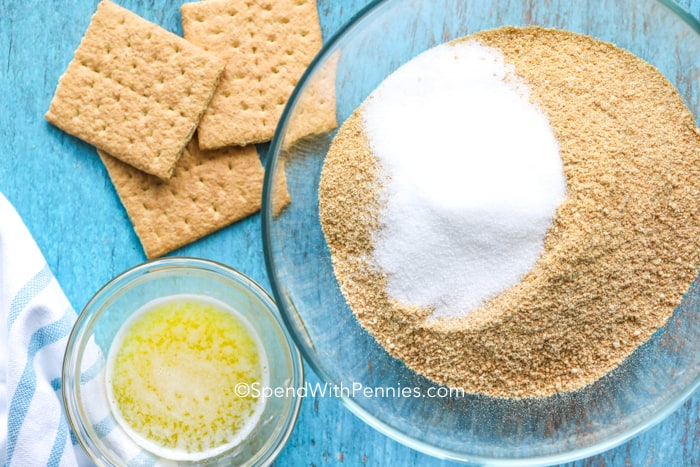 Ingredients for graham cracker pie crust ready to be mixed