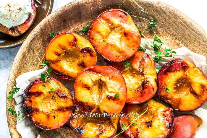 Grilled Peaches in a wooden bowl