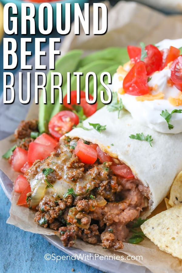 Close up of a ground beef burrito on a plate.
