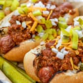 Hot dogs topped with chili sauce
