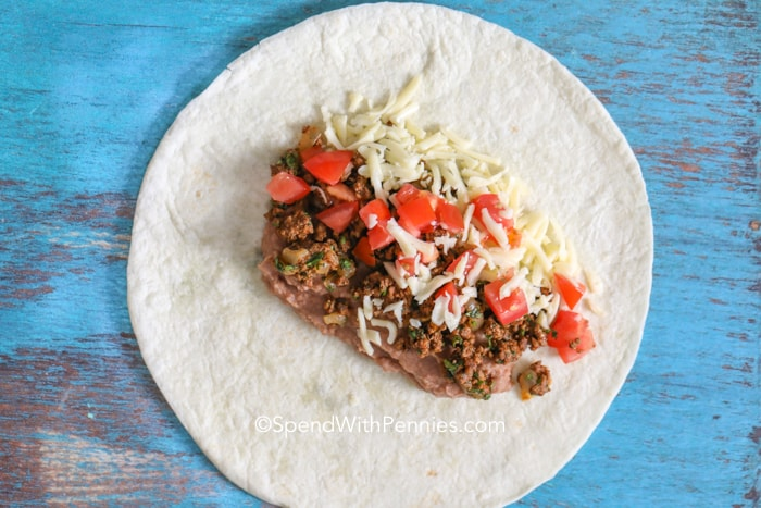Ground beef burrito fillings on a flour tortillas