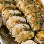slices of Instant Pot Pork Tenderloin with gravy
