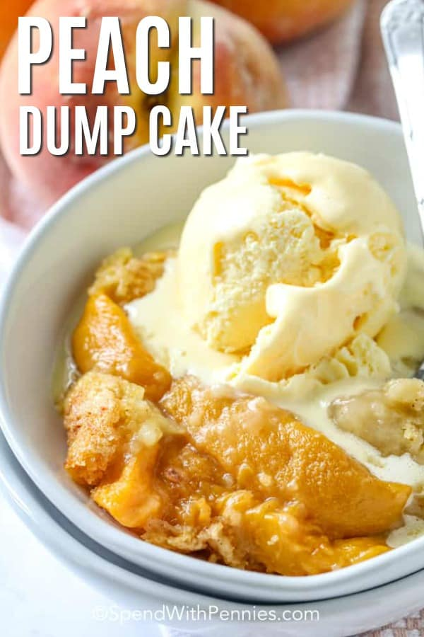 A serving of peach dump cake in a bowl topped with ice cream.