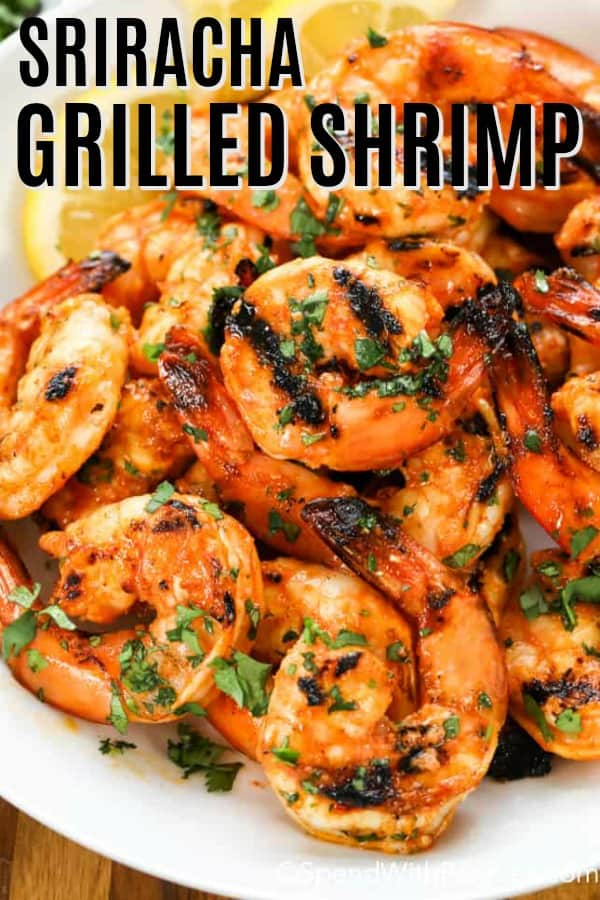 Sriracha Grilled Shrimp on a white plate with a title