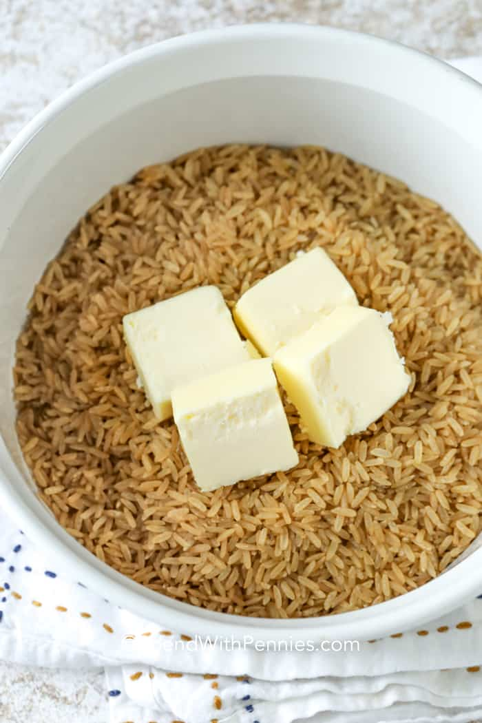 Casserole dish with brown rice and butter