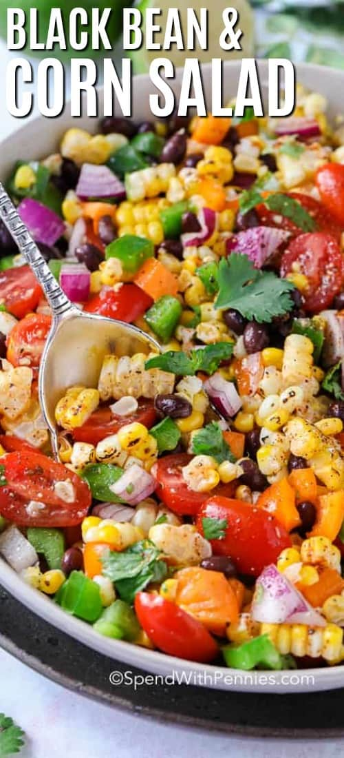 Black Bean Corn Salad in a bowl with a silver spoon for serving