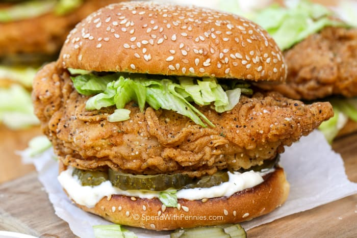 Crispy Chicken Sandwich with pickles, lettuce and mayonnaise topped with a sesame seed bun
