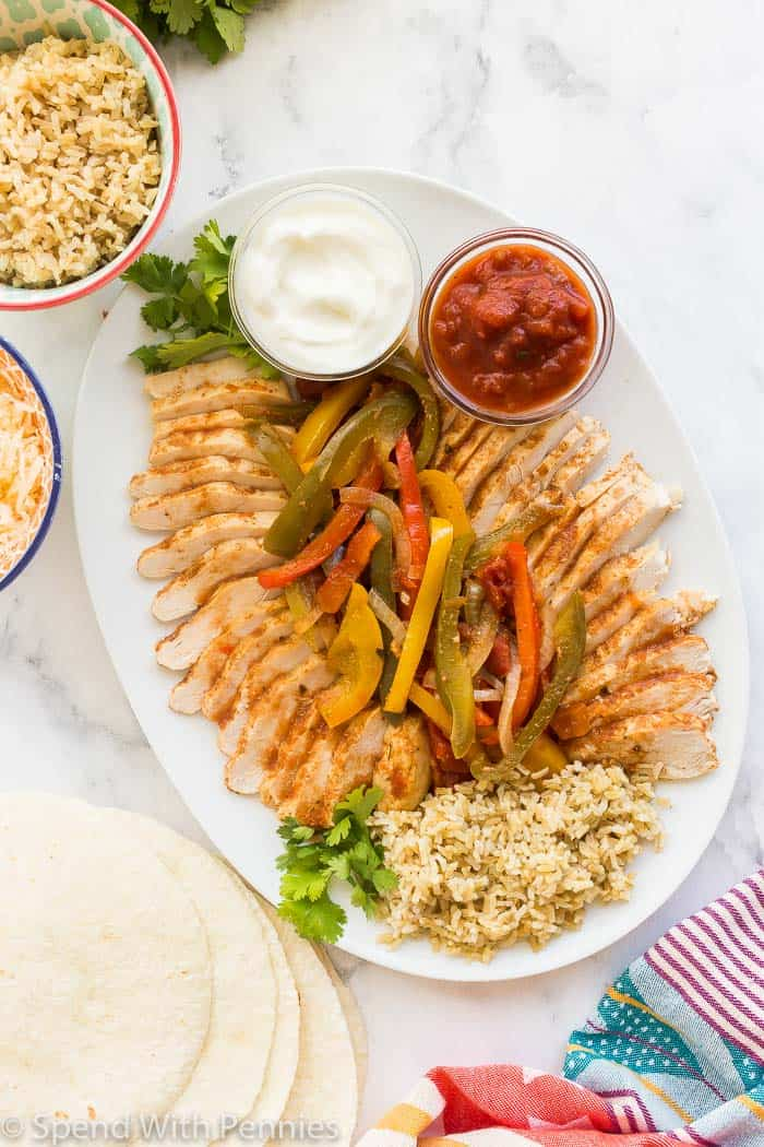 crockpot chicken fajitas on white platter