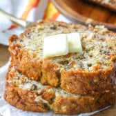 Slices of carrot banana bread with squares of butter