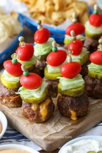Cheeseburger stuffed meatballs on parchment paper