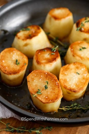 Fondant potatoes with thyme in a pan