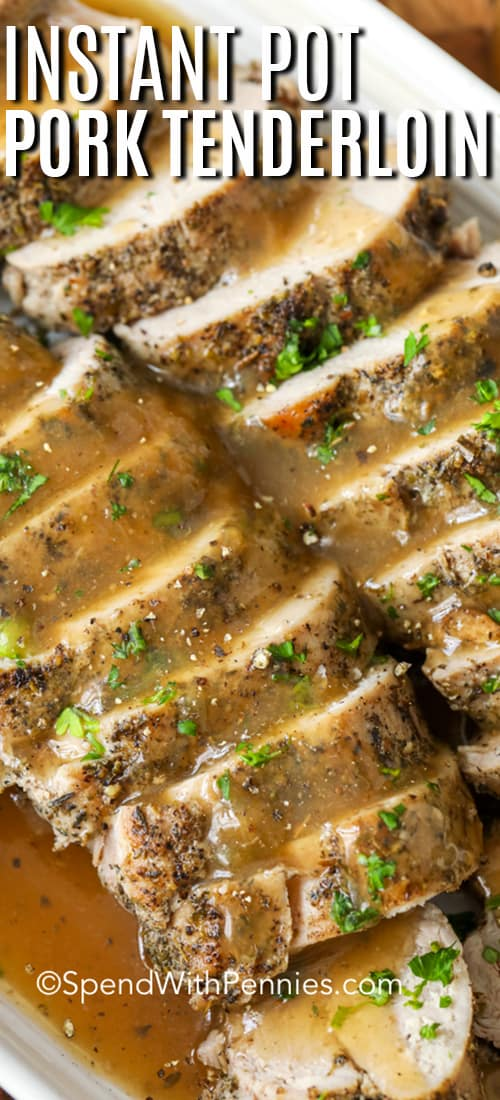 Close up of instant pot pork tenderloin with gravy, garnished with parsley.
