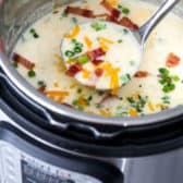 Instant pot potato soup in an instant pot with a ladle