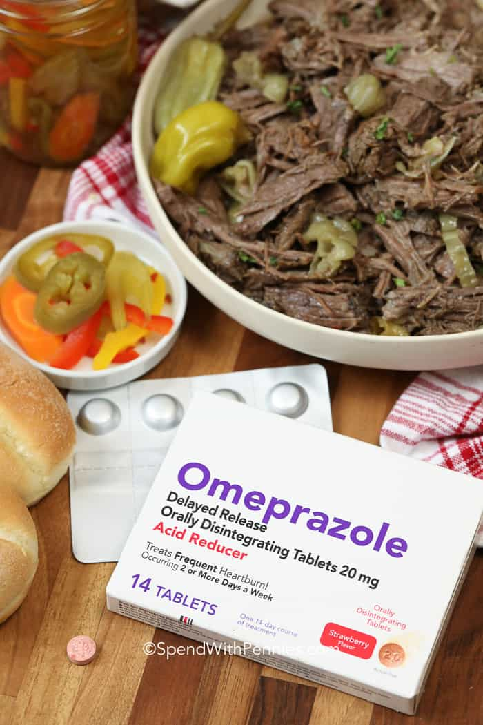 Italian beef sandwich ingredients on a wooden board with Omeprazole