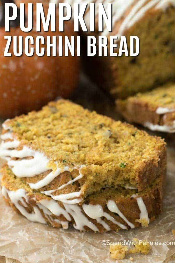 Pumpkin zucchini bread on parchment paper with a bite taken out of one with a title