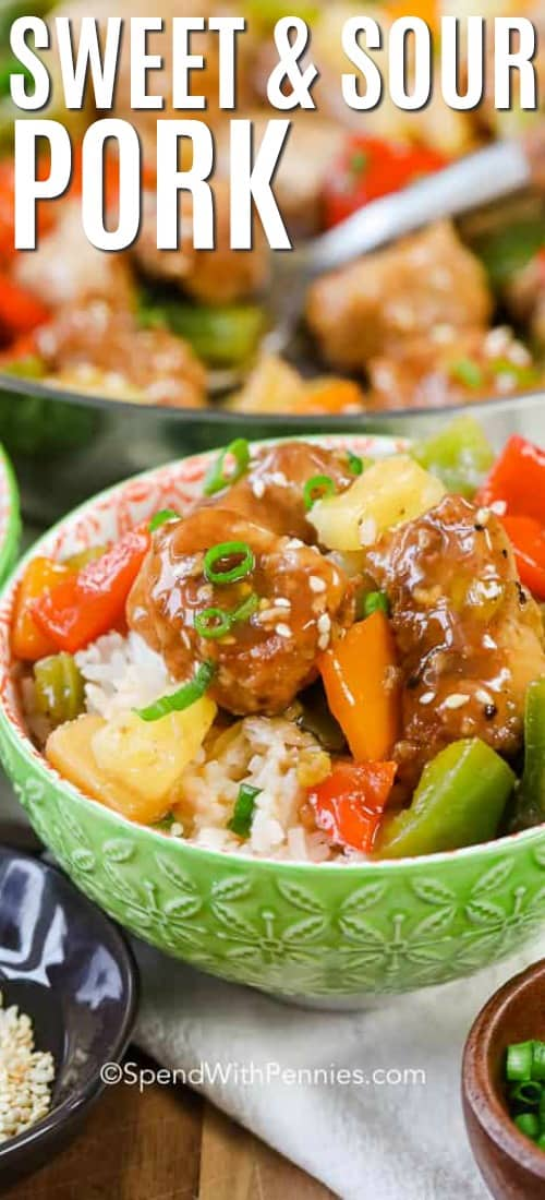 A bowl of sweet and sour pork with rice topped with green onions