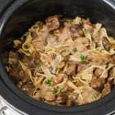 Crockpot beef stroganoff in a Crock-Pot with parsley on top