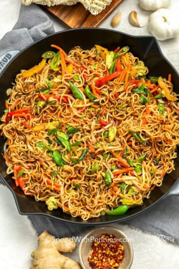 Easy Ramen stir fry in a Pan with ginger and garlic on the side