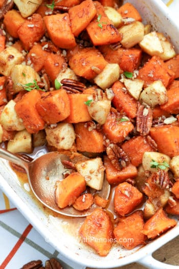 taking a spoonful of sweet potato and apple casserole