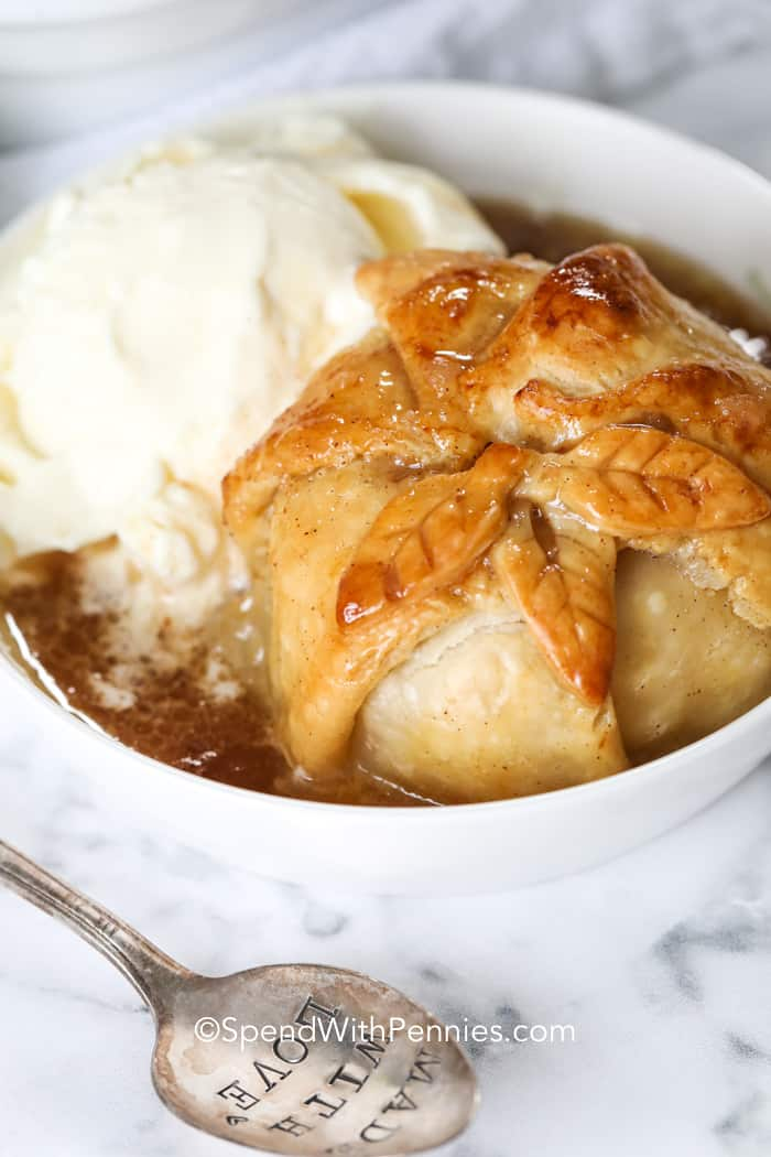 Apple Dumpling in a bowl with ice cream and a spoon